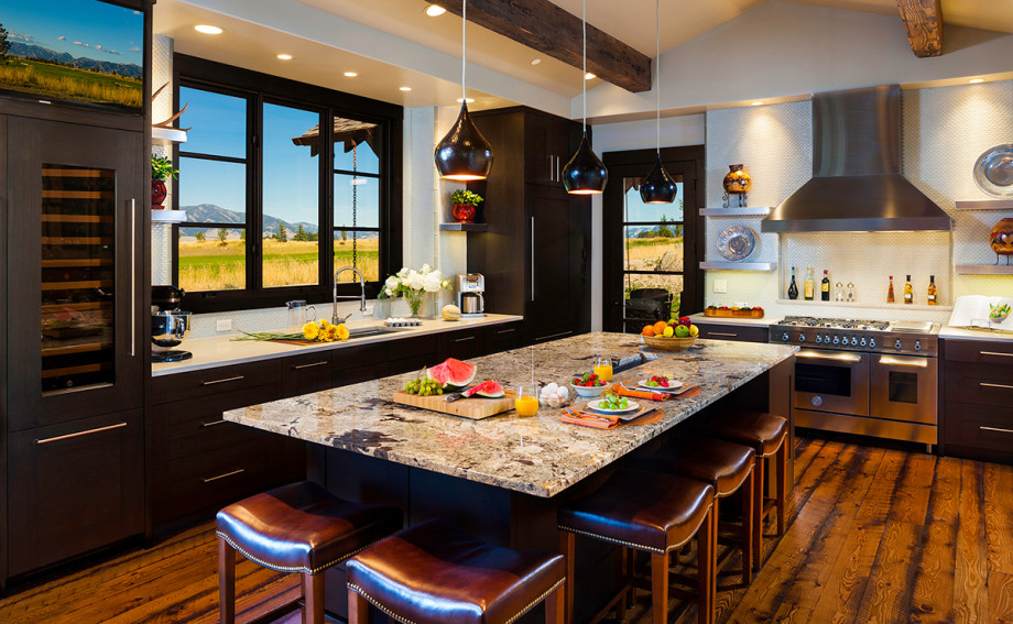 black bull bozeman custom home modern kitchen with barnwood floors and views of the Bridgers