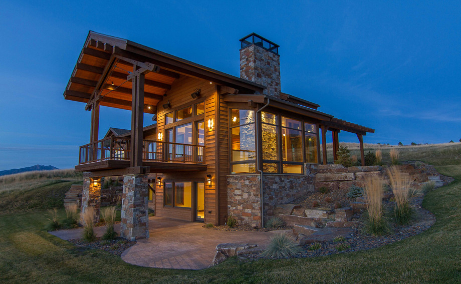 Rustic Meets Modern in this custom Home in Montana with stacked rock and floor-to-ceiling windows
