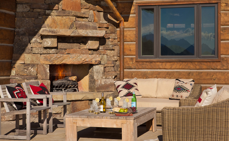 outdoor living area with custom built fireplace in Bozeman Montana
