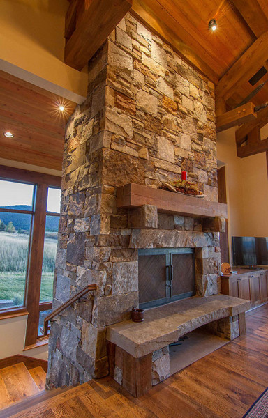 custom built stacked stone fireplace in a Montana custom home