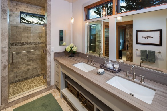 beautiful custom bathroom with light colored tile throughout