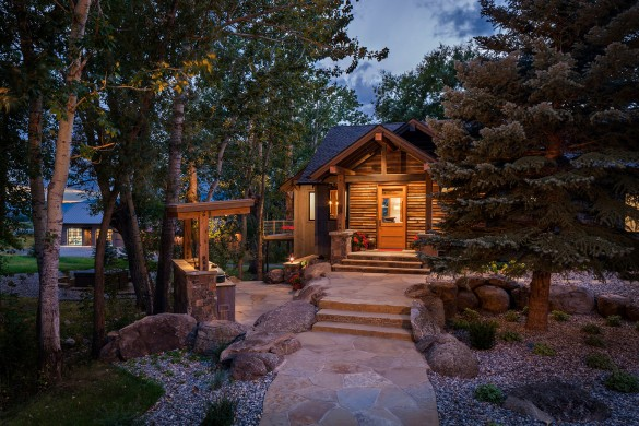 livingston montana custom home lit at dusk