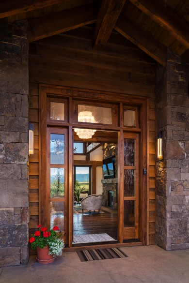 details like rough-hewn planks and a stacked stone entryway