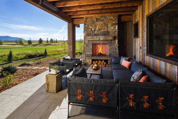 amazing custom fireplace with stacked stone and bardwood siding on this custom home in bozeman montana