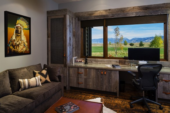 views of the mountains from this custom-built home office with barnwood cabinets featuring leather drawer pulls