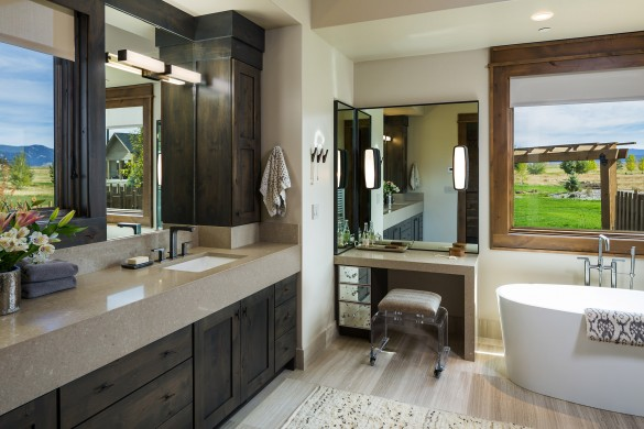 the ultimate in luxury, this bathroom features a soaking tub and custom rustic cabinets with views of the mountains