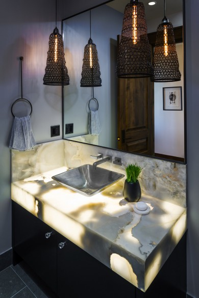 beautiful lit vanity with stone lit from within make this unique custom bathroom design one of a kind