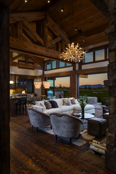 rough-hewn floor planks and a custom ekhorn-inspired lighting fixure are show stopping pieces of this custom home in bozeman montana