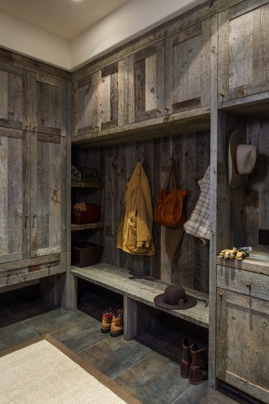 one of the best mudroom designs, this barnwood and slate room has a place for everything and goes perfectly with this modern-rustic  custom home