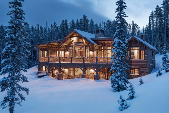 beautiful custom mountain home in montana surrounded by woods in the winter